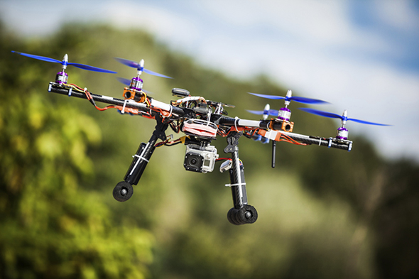 Professional carbon drone with GPS making a ride.