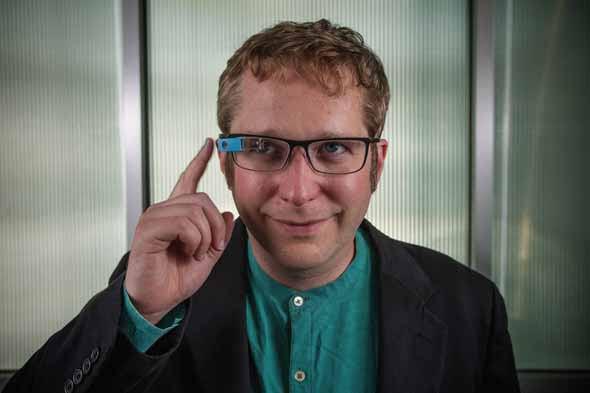 Thad Starner, professor in the school of Interactive Computing, with Google Glass (pictured) and a few of the different iterations of his older wearable computers.